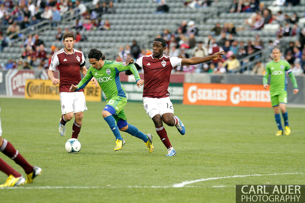 April 20th, 2013 Commerce City, CO - Seattle Sounders FC midfielder Mauro Rosales (10) attempts to get past the defense by Colorado Rapids midfielder Hendry Thomas (12) in the second half of the MLS match between the Seattle Sounders FC and the Colorado Rapids at Dick's Sporting Goods Park in Commerce City, CO