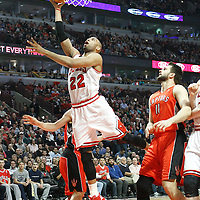 24 March 2012: Chicago Bulls forward Taj Gibson (22) goes for the layup past Toronto Raptors small forward Linas Kleiza (11) during the Chicago Bulls 102-101 victory in overtime over the Toronto Raptors at the United Center, Chicago, Illinois, USA.