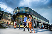 The new Student Life and Wellness Center exterior shots with students, Shot on the roof of the Library and down on sidewalk, Wednesday August 20, 2014, Utah Valley University (Nathaniel Ray Edwards, UVU Marketing)