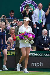 LONDON, ENGLAND - Saturday, July 5, 2014: Eugenie Bouchard (CAN) walks onto centre court before the Ladies' Singles Final match on day twelve of the Wimbledon Lawn Tennis Championships at the All England Lawn Tennis and Croquet Club. (Pic by David Rawcliffe/Propaganda)