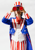 Uncle Sam looking through binoculars on a white background...Model Release: 20080813_MR_A