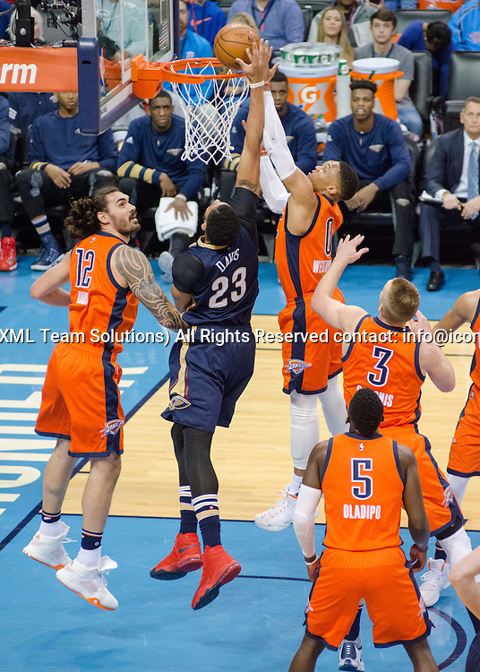 OKLAHOMA CITY, OK - DECEMBER 04:   New Orleans Pelicans Forward Anthony Davis (23) going for two points while Oklahoma City Thunder Guard Russell Westbrook (0) going for the block on December 04, 2016, at the Chesapeake Energy Arena Oklahoma City, OK. (Photo by Torrey Purvey/Icon Sportswire)