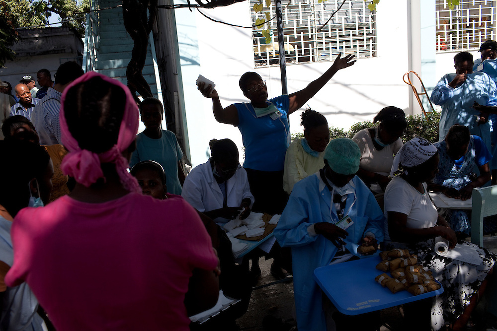 Staff at the St. Francois De Sales hospital sing and pray while doing their work outside in Port-au-Prince, Haiti. The main hospital building collapsed in the recent earthquake, and patients are being treated in the courtyard.