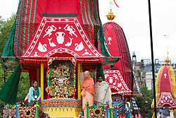 © Licensed to London News Pictures. 09/06/2013. London, UK. Followers of the Hare Krishna movement are seen on chariots bearing Hyde Park, London, today (09/06/2013) before being pulled to Trafalgar Square as part of the 'Hare Krishna' festival of 'Rathayatra'. The parade, also known as the 'Festival of Chariots', is the biggest street festival celebrated by members of the Krishna followers and, in London, features three huge, wooden chariots containing the smiling figures of Lord Jagannatha, Lady Subhadra and Lord Balarama being pulled by hand from Hyde Park to Trafalgar Square.  Photo credit: Matt Cetti-Roberts/LNP