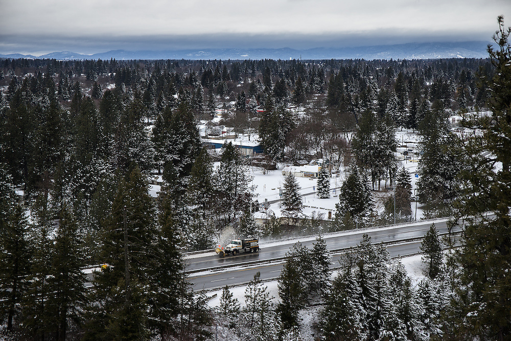 GABE GREEN/Press<br /> <br /> Plows blast snow from the shoulder of I-90 in Coeur d&rsquo;Alene Thursday after a dusting of snow hit the area.