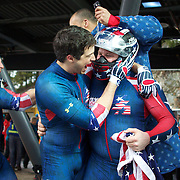 "Winter Olympics, Vancouver, 2010.The USA-1 team of Steven Holcomb, Justin Olsen, Steve Mesler and Curtis Tomasezicz win the Gold Medal in the Bobsleigh Four-man at The Whistler Sliding Centre, Whistler, during the Vancouver Winter Olympics. 27th February 2010. Photo Tim Clayton..'BOB'..Images from the Four-man Bobsleigh Competition. Winter Olympics, Vancouver 2010..History was made at the Whistler Sliding Centre when the USA four-man bobsleigh team, led by Steven Holcomb took the Gold. The first time since 1948, a gap of 62 years, since the USA have won an Olympic Bobsleigh gold and they did it with their sleigh named ""Night Train""...The four days of practice and competition show the tension, nervousness and preparation as the teams of hardened men cope with the challenge of traveling at average speeds of over 150 km an hour. Indeed, five teams had already pulled out of the event before the opening heats because of track complexity, speed and fear, and on the final day, another four teams did not start after six crashes in the first two heats...Teams warm up behind the start complex, warming muscles in the cold in preparation for the explosive start. Many teams prepare in silence, mentally preparing themselves as they wait at the top of the run, in the bobsleigh sheds and the loading areas for their turn. When it's time to slide each team performs it's own starting ritual, followed by the much practiced start out of the blocks for just over four seconds, the teams are then in the hands of the accomplished drivers as they hurtle down the track for just over fifty seconds...Spectators clamber for the best position on track to see the sleighs for a split second, many unsuccessfully try to capture the moments on camera, The rumble of the sleigh is heard then the crowds gasp as it hurtles past in a blur...The American foursome of  Steven Holcomb, Justin Olsen, Steve Mesler and Curtis Tomasevicz finished with a pooled four-heat time of 3min 24.46sec. The German team led b"