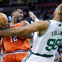 21 December 2012: Boston Celtics center Jason Collins (98) defends on Milwaukee Bucks power forward Luc Richard Mbah a Moute (12) during the Milwaukee Bucks 99-94 overtime victory over the Boston Celtics at the TD Garden, Boston, Massachusetts, USA.