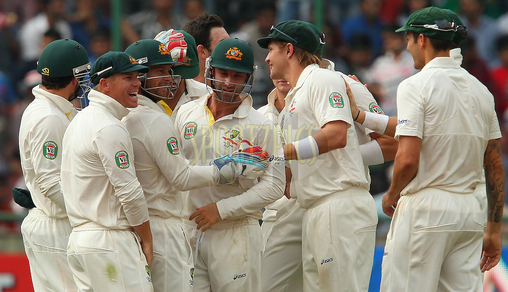 Australia celebrate the wicket of Ajinkya Rahane of India during day 3 of the 4th Test Match between India and Australia held at the Feroz Shah Kotla stadium in Delhi on the 24th March 2013..Photo by Ron Gaunt/BCCI/SPORTZPICS ..Use of this image is subject to the terms and conditions as outlined by the BCCI. These terms can be found by following this link:..http://www.sportzpics.co.za/image/I0000SoRagM2cIEc