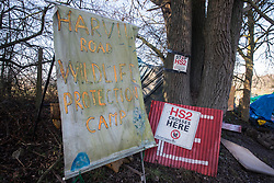 Harefield, UK. 21 January, 2020. A banner and signs at the roadside site of the Save the Colne Valley Stop HS2 wildlife protection camp on Harvil Road. Activists reoccupied the field behind the roadside camp on 18th January in order to seek to protect ancient woodland set to be destroyed by HS2.
