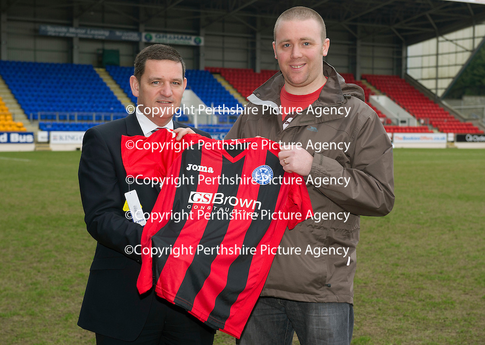 St Johnstone Chairman Steve Brown pictured with the away strip for next season 2013-14 which is based on the Eskisehirspor strip, whom St Johnstone played in the Europa League this season, also pictured is lifelong saints fan Kevin Heller who suggested the idea to the club.<br /> Picture by Graeme Hart.<br /> Copyright Perthshire Picture Agency<br /> Tel: 01738 623350  Mobile: 07990 594431