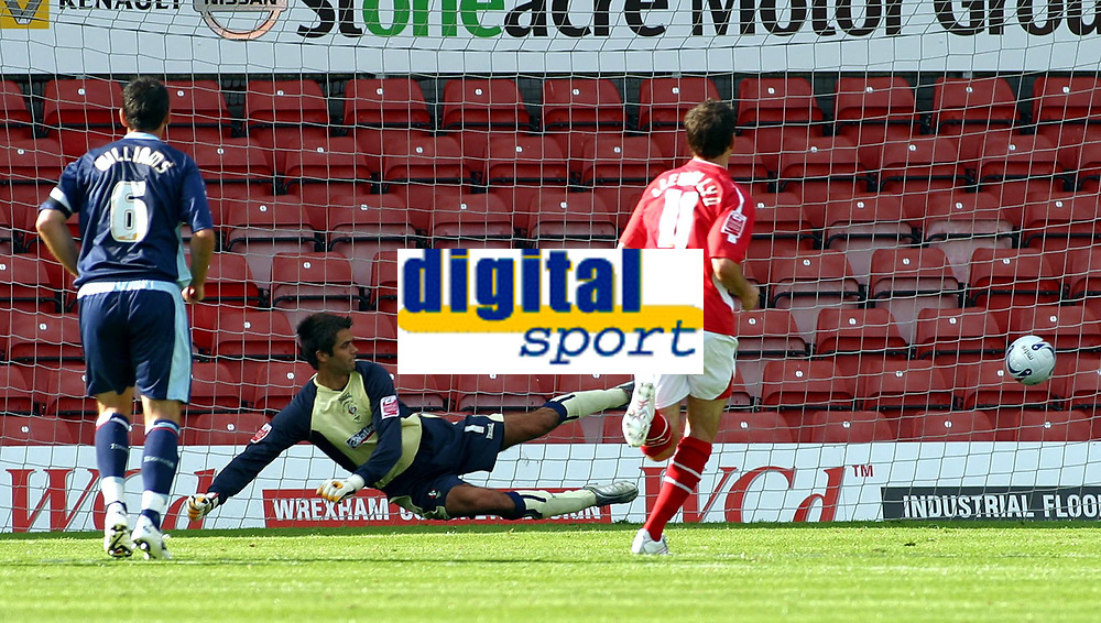 Photo: Dave Linney.<br />Wrexham v Swindon Town. Coca Cola League 2. 09/09/2006.Wrexham's Chris Llewellyn (11) sends keeper Peter Brezovan the wrong way.