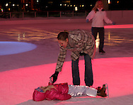 Nicole Whiteaker of Geermantown helps daughter Rachel, 6 up after a spil during Horse-Drawn Carriage Rides & Star Late Skate night at RiverScape MetroPark in downtown Dayton, Saturday, December 18, 2010.