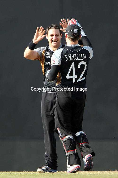 Nathan McCullum celebrates the wicket of Marlon Samuels of The West Indies with Brendon McCullum during the ICC World Twenty20 Super Eights match between The West Indies and New Zealand held at the  Pallekele Stadium in Kandy, Sri Lanka on the 1st October 2012<br /> <br /> Photo by Ron Gaunt/SPORTZPICS/PHOTOSPORT