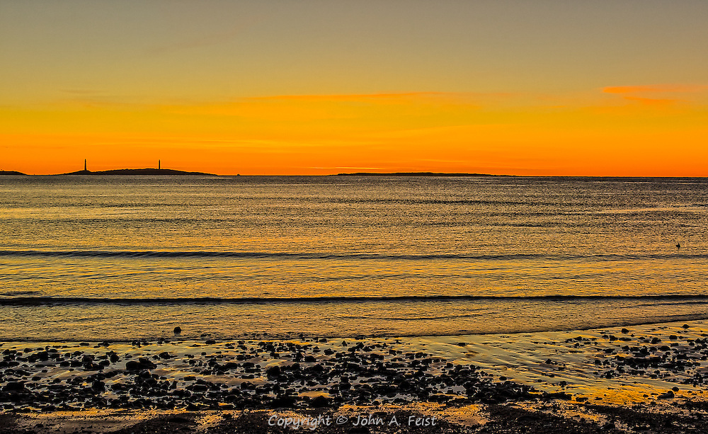 I was very fortunate to have a clear sky and a beautiful sunrise for our last day on Cape Ann, MA.  The tide was going out as the sun rose, revealing not just the beautiful colors on the horizon, but also the rocky bottom close to shore.