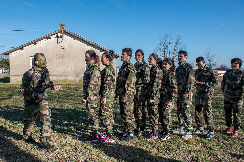 LYON, FRANCE - FEBRURAY 09:<br /> In collaboration with the military units of the military camp &quot;La Valbonne&quot;, near Lyon, 40 students of IDRAC management school were welcomed for a training.<br /> The students, dressed like soldiers, were supervised by soldiers of the 68th Field Artillery Regiment African Medical Regiment of operational health and Training Centre Detachment 278 Air Amb&eacute;rieu. <br /> They were there to test their leadership skills but also to learn how to manage crisis situations<br /> It was the 3rd edition of this internship very appreciated by the students and by the supervisory staff of the Defense Base.<br /> It joins within the framework of the academic trinomial of Lyon constituted of the Ministries of Defense and Education and the Institute of Advanced Studies of National Defence (IHEDN).