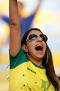 A Brazilian fan reacts to Brazil inning the penalty shootout v Chile which was shown ion the big screens in the Maracana before the 2014 FIFA World Cup last 16 match at Maracana Stadium, Rio de Janeiro, Brazil.<br /> Picture by Andrew Tobin/Focus Images Ltd +44 7710 761829<br /> 28/06/2014