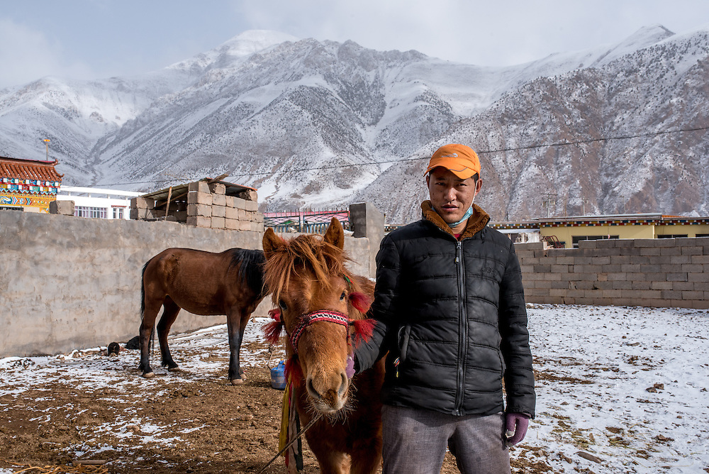 A resident of Zado, Tibet (Qinghai, China), with his horses.