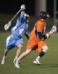 Virginia Cavaliers M Max Pomper (42) avoids North Carolina Tar Heels Rob Driscoll (40).  The Virginia Cavaliers Men's Lacrosse Team defeated the North Carolina Tar Heels 10-9 in overtime at Klockner Stadium in Charlottesville, VA on April 7, 2007.