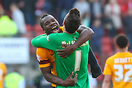 Aaron McLean of Bradford City (left) celebrates with Jon McLaughlin of Bradford City after the Sky Bet League 1 match at the Matchroom Stadium, London<br /> Picture by David Horn/Focus Images Ltd +44 7545 970036<br /> 29/03/2014