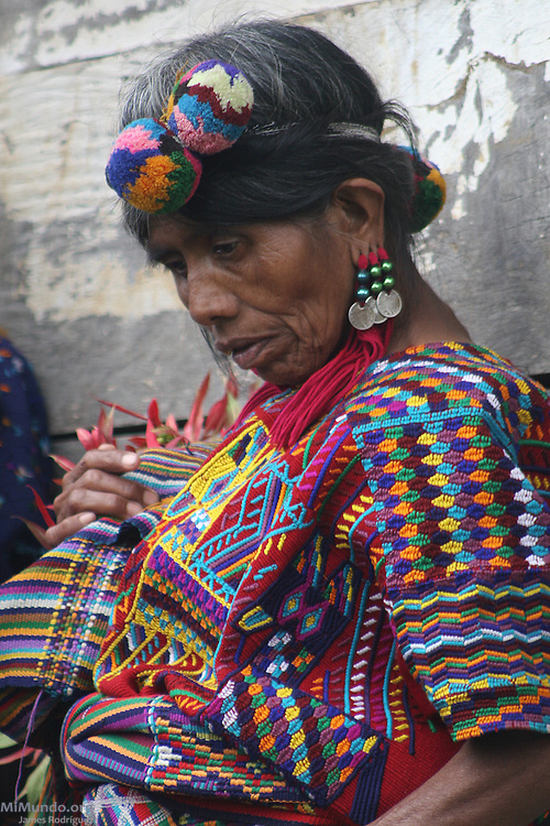 An Ixil Mayan woman from Chajul awaits to receive the remains of a family member killed during the Guatemalan internal armed conflict in the early 1980s. The National Coordination for Guatemalan Widows (CONAVIGUA) and the Forensic Anthropological Foundation of Guatemala (FAFG) returned the remains of 14 wartime victims to their respective family members in the hamlet of Xaxmoxan, Chajul, up in the Ixil Mayan highlands of Quiché after successful exhumations of clandestine mass graves. Most of the victims perished in the mountainside between 1980 and 1983 as they fled the Army's brutal Scorched Earth campaign against a civil population accused of supporting the guerrilla groups in the region. Xaxmoxan, Chajul, Quiché, Guatemala. January 25, 2007.