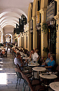 GREECE. Ionian Islands: Colonnaded streets provide shelter for numerous fashionabe cafes.Corfu town. .