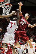 Utah guard Anthony Odunsi (3) is fouled as attempts to score against Stanford forward Dwight Powell (33) during the first half of an NCAA college basketball game, Saturday, Feb. 25, 2012, in Salt Lake City. (AP Photo/Colin E Braley).