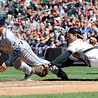 12 April 2009:  Baltimore Orioles catcher Chad Moeller (16) dives and tags out Tampa Bay Rays right fielder Gabe Gross (26) after he missed the plate in the 4th inning on April 12, 2009 at Camden Yards in Baltimore, MD.  The Rays defeated the Orioles 11-3.  ****For Editorial Use Only****