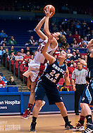 Rhode Island freshman Megan Straumann (24) watches as UD senior Justine Raterman (34) takes a shot in the first half as the Rhode Island Rams play the University of Dayton Flyers at UD Arena in Dayton, Saturday, January 7, 2012.<br /> Photo by Mickey Shuey