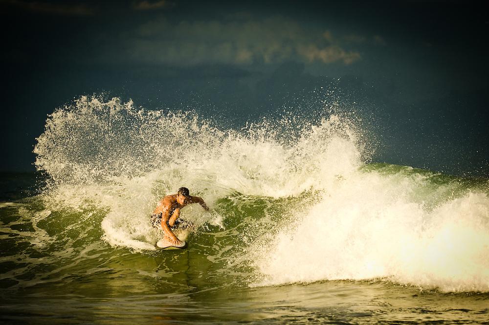 A surfer shot during Hurricane Bill at Sebastian Inlet in Sebastian, Florida.