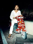 Man sitting on his moped Ibiza 1999