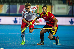 England's Harry Martin goes past Pau Quemada of Spain. England v Spain - Unibet EuroHockey Championships, Lee Valley Hockey & Tennis Centre, London, UK on 25 August 2015. Photo: Simon Parker