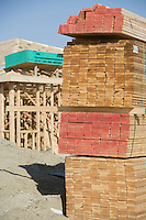 Wooden planks stacked on construction site