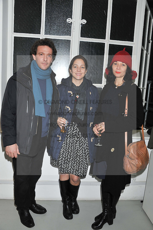 Left to right, BENEDETTO PIETROMARCHI, SARAH MONTI and ORSOLA DE CASTRO at a private view of Tobias Rehberger's latest work entitled 'Sex and Friends' held at the Pilar Corrias Gallery, 54 Eastcastle Street, London W1 on 12th January 2012.