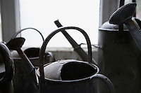 Close-up of old watering cans