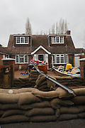 Sand bags and water pump flood defences on Ham Island. Flood waters remain high after last weeks flooding across the Thames valley. UK<br /> <br /> Picture by Zute Lightfoot