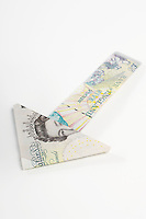 Arrow made of folded banknotes
