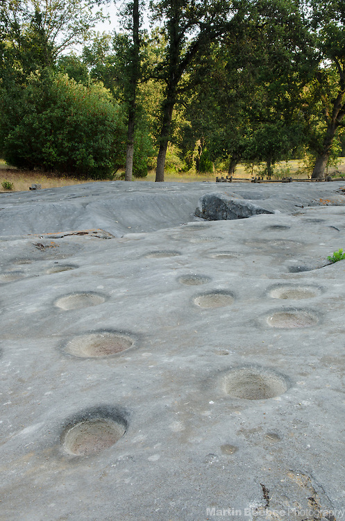 Outcropping of mortar holes, Indian Grinding Rock State Historic Park, Amador County, California