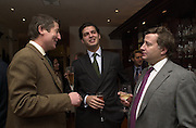 Prince Casimir zu Sayn Wittgenstein, ( centre ) and Simon Phillips. Gunmaker's Boss and Co's launch party new Mayfair premises. Mount St. London. 12 December 2000. © Copyright Photograph by Dafydd Jones 66 Stockwell Park Rd. London SW9 0DA Tel 020 7733 0108 www.dafjones.com