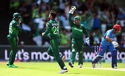 Pakistan's Shadab Khan celebrates taking the wicket of Afghanistan's Asghar Afghan during the ICC Cricket World Cup group stage match at Headingley, Leeds.