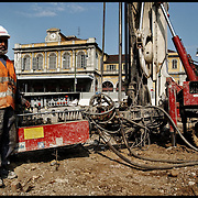 Immigrato al lavoro nel cantiere della metropolitana a Porta Susa,  Torino 2002.