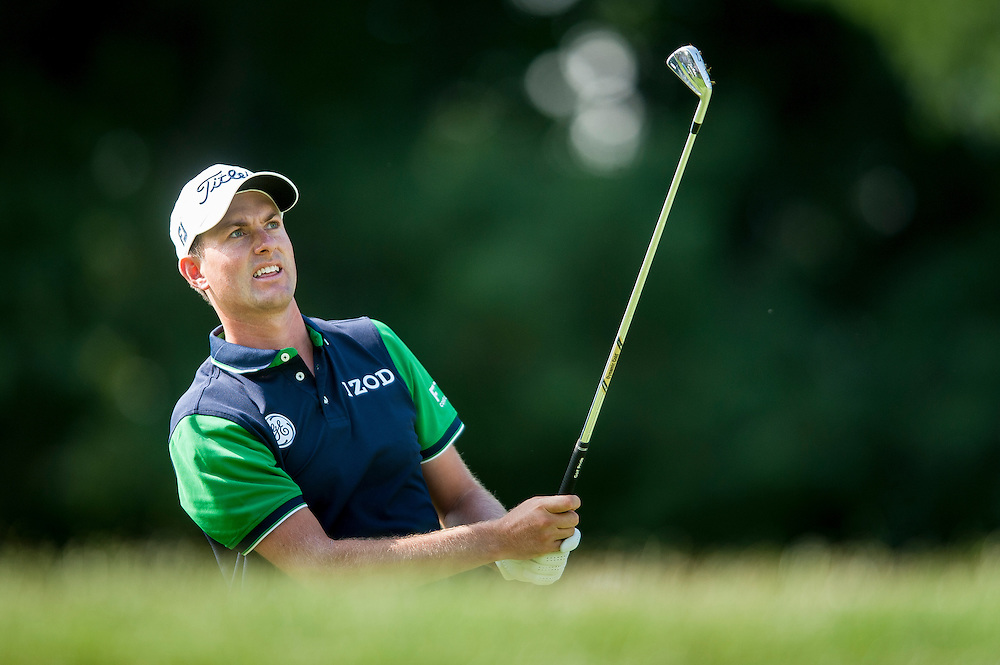 Webb Simpson hits his approach shot in the 17th hole during the first round of the Quicken Loans National golf tournament on Wednesday at Congressional Country Club in Bethesda, Maryland.