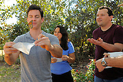 Host Brandon Johnson releases a Monarch butterfly as homeowners John and Ileana Trautwein watch. The three released 4 dozen butterflies - two dozen Monarchs and two dozen Painted Ladies. As seen on HGTV's My Yard Goes Disney.