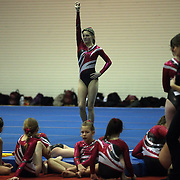 Young gymnasts wait for competition as a competitor performs her floor routine during competition at the 21st American Invitational 2014 competition at the XL Centre. Hartford, Connecticut, USA. USA. 31st January 2014. Photo Tim Clayton