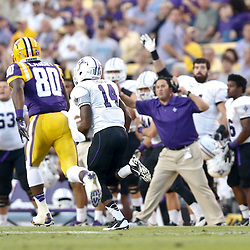 Oct 26, 2013; Baton Rouge, LA, USA; Furman Paladins cornerback Reggie Thomas (14) returns an interception for a touchdown during the first quarter of a game against the LSU Tigers at Tiger Stadium. Mandatory Credit: Derick E. Hingle-USA TODAY Sports