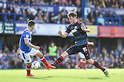 Doncaster Rovers Defender, Joe Wright (15) beats Portsmouth Forward, Conor Chaplin (19) to the ball during the EFL Sky Bet League 2 match between Portsmouth and Doncaster Rovers at Fratton Park, Portsmouth, England on 1 October 2016. Photo by Adam Rivers.