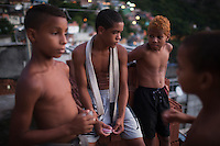 Favela boys hang out waiting for their mix-martial arts class to start, in Rocinha, the biggest favela in Brazil, with over 100,000 residents, in Rio de Janeiro, Br., on Thursday, Jan. 24, 2013.