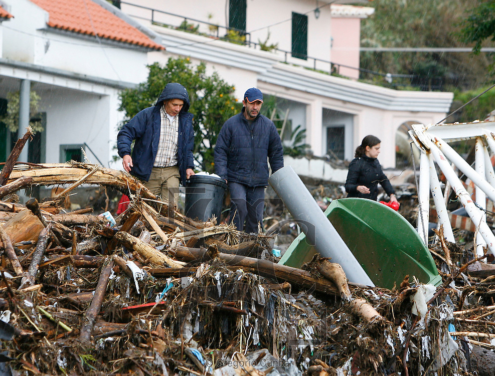 Villagers collect their belongings in Funchal, Madeira Island, on February 22, 2010. Residents fled their homes for fear of new mudslides on the tourist island of Madeira as Portugal decreed three days of mourning for the 42 people killed in weekend flash floods. .Photo Gregorio Cunha