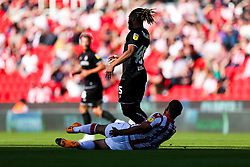 Kasey Palmer of Bristol City is tackled by Cameron Carter-Vickers of Stoke City - Rogan/JMP - 14/09/2019 - Bet365 Stadium - Stoke, England - Stoke City v Bristol City - Sky Bet Championship.