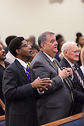 North Charleston Police Chief Eddie Driggers and Assistant Police Chief Reggie Burgess (left) listen to Rev. Al Sharpton address a healing service at Charity Missionary Baptist Church April 12, 2015 in North Charleston, South Carolina. Sharpton spoke following the recent fatal shooting of unarmed motorist Walter Scott police and thanked the Mayor and Police Chief for doing the right thing in charging the officer with murder.