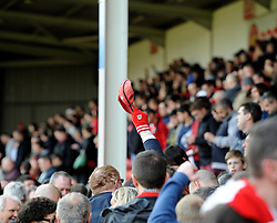 A Bristol City fan raises his cap after the game to recognise the win  - Photo mandatory by-line: Joe Meredith/JMP - Mobile: 07966 386802 12/04/2014 - SPORT - FOOTBALL - Walsall - Banks' Stadium - Walsall v Bristol City - Sky Bet League One